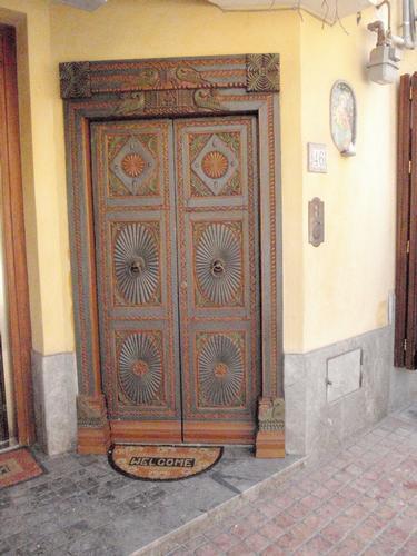 Porta intarsiata  - Altavilla milicia (1135 clic)