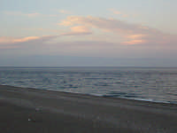 La spiaggia di Alì Terme al crepuscolo di giugno con la costa calabrese di sfondo  - Alì terme (7078 clic)