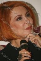 Rossa passionale Marina Ripa di Meana, in conferenza stampa a Viagrande. Ph Angy Platania  - Viagrande (3516 clic)