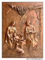 Floridia: Chiesa madre in piazza del Popolo. Particolare del portone Bronzeo con altorilievi. #3  - Floridia (3609 clic)