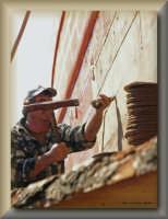 mastro d'ascia intento a calatafare  - Licata (2029 clic)