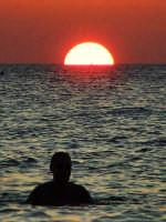 tramonto a mare. guardando l'orizzonte PALERMO Gabriele Saito