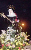 S. Rita - Ogni anno, nei tre giorni successivi la Pentecoste, viene celebrata la festa del SS. Crocifisso, pregiata scultura lignea realizzata da Ignazio Marabitti , conservata nella Chiesa di S. Caterina.Il piccolo Crocifisso dei Miracoli, u Crucifisseddu di Chiusa, viene portato in processione insieme ad altre statue di Santi e, in tale occasione, un tempo si svolgeva la corsa dei cavalli nella via principale. (Totò Mirabile)  - Chiusa sclafani (3742 clic)