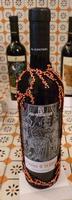 Etichetta della stilista Marella Ferrera La bottiglia realizzata dalla stilista Marella Ferrera in occasione dell'asta di beneficienza alla Fondazione La Verde La Malfa  - San giovanni la punta (6816 clic)