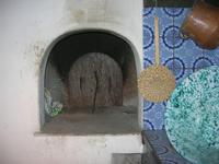 Le Grotte di Custonaci - Grotta preistorica Scurati - borgo rurale costruito più di un secolo fa ed abitato fino alla seconda guerra mondiale - civiltà contadina: un angolo della cucina e forno - 14 marzo 2010   - Custonaci (1870 clic)