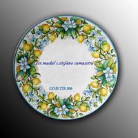 Tavolo in pietra lavica decorato con limoni e fiori  con fondo blu  codice-TD306 cm.120  - Santo stefano di camastra (3993 clic)