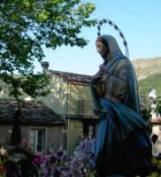 Processione dell'immacolata,con vista sullo sfondo di Padre Pio.  - Novara di sicilia (7507 clic)