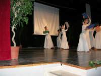 Teatro Euro - Le ragazze della scuola di danza Arte Libera, portano simbolici doni a Don Bosco dopo essersi esibite ne I Ricordi, prologo della conferenza tenuta dal Dott. Carmelo Impera sul tema Educare oggi giovani e famiglie - Un modello per promuovere l'agio e prevenire il disagio, organizzata dall'Opera Salesiana Don Bosco di Alcamo ed il Centro Socio-Psico-Pedagogico Carl Rogers - Comunità di Accoglienza Oasi Don Bosco di Ispica (RG) - 29 gennaio 2006  - Alcamo (1364 clic)