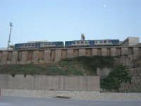 dal porto: il treno fermo alla stazione (e la luna sta a guardare) - 12 luglio 2008   - Balestrate (1104 clic)