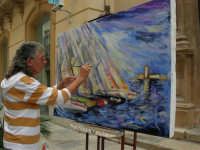Pittore, in via Garibaldi, dipinge un suo quadro in occasione dell'America's Cup - 2 ottobre 2005   - Trapani (3562 clic)