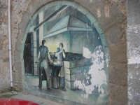 per le vie di Vita - murales - Mestieri e tradizioni della civiltà contadina: fabbro ferraio che lavora, aiutato da un garzone - 9 ottobre 2007   - Vita (3469 clic)