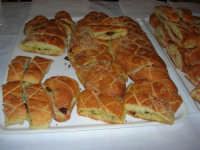 Cene di San Giuseppe - degustazione prodotti tipici gastronomici: Lu pani cunzatu - 15 marzo 2009   - Salemi (3596 clic)