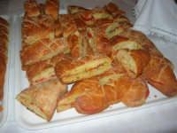 Cene di San Giuseppe - degustazione prodotti tipici gastronomici: Lu pani cunzatu - 15 marzo 2009   - Salemi (3320 clic)
