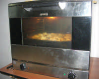 Cene di San Giuseppe - lavorazione del pane (la cottura al forno) - 15 marzo 2009   - Salemi (2597 clic)