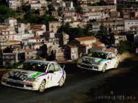 1° Rally Di Montagnareale 30-02-2005. Le macchine si danno battaglia sulla strada di S.Marco;sullo sfondo il paese di Montagnareale.  - Montagnareale (3349 clic)