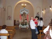 S.Sebastiano;processione. nella foto la statua nella chiesetta di S.Sebastiano-in primo piano il Sign Addeo Antonio.  - Montagnareale (3309 clic)