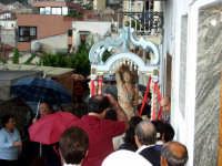 S.Sebastiano sotto la pioggia;processione  - Montagnareale (1980 clic)