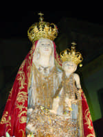 Simulacro di Maria SS. della Catena sul fercolo per le vie del paese nel giorno della festa ( Maggio ).  - Castiglione di sicilia (2317 clic)