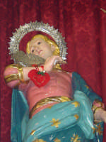 I santi martiri Alfio, Filadelfo e Cirino sull'altare maggiore nel giorno della festa ( prima domenica di maggio ), particolare della statua di S.Filadelfo.  - Sant'alfio (3208 clic)