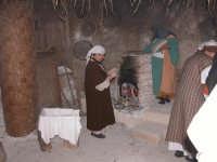 Presepe vivente 2005  la cottura del pane azzimo   - Caltagirone (2400 clic)
